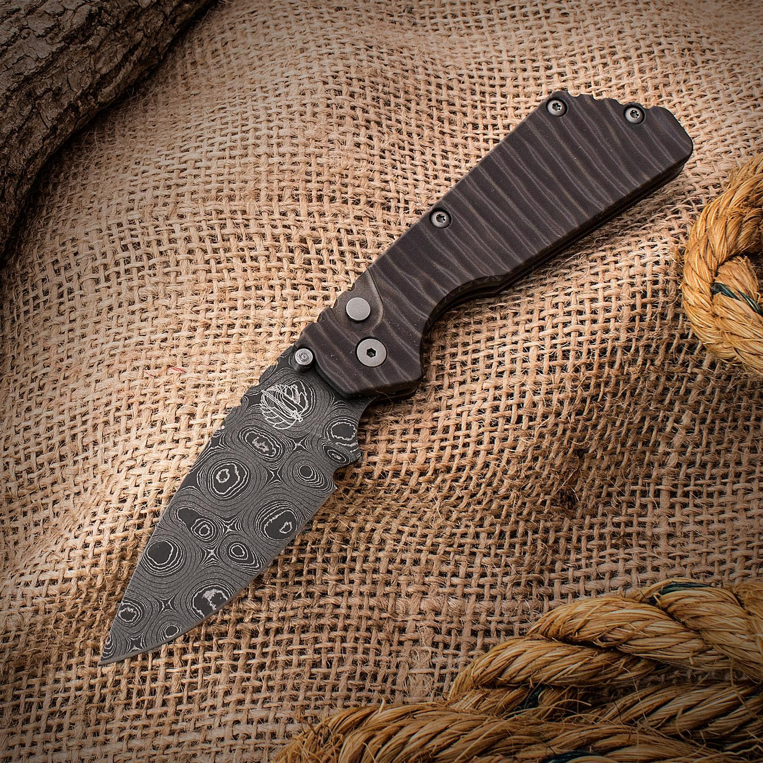 Автоматический складной нож Pro-Strider SnG Auto, Chad Nichols Black Eye Stainless Damascus, Flamed Titanium HandlesРаскладные ножи<br>Автоматический складной нож Pro-Strider SnG Auto, Chad Nichols Black Eye Stainless Damascus, Flamed Titanium Handles<br>