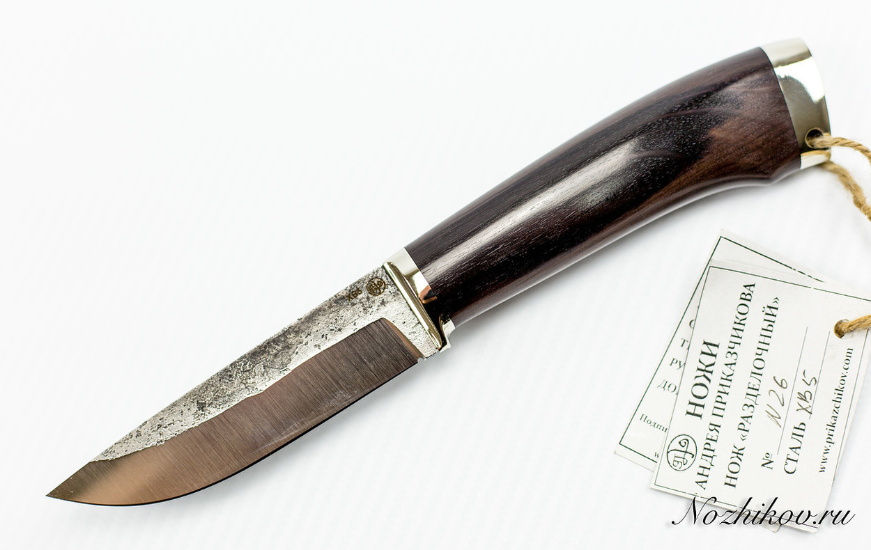 Нож Разделочный №26 из кованой стали ХВ5Ножи Павлово<br>Сталь: ХВ5Рукоять: граб, литье мельхиорДлина клинка (мм.): 115 Наибольшая ширина клинка (мм.): 29 Толщина обуха клинка (мм.): 3.5 Толщина подвода (мм.): 0,3-0,5 Твердость стали: 64-65Hrc Общая длина ножа (мм.): 250 Поверхность клинка: Сатин Спуски клинка: Прямые<br>