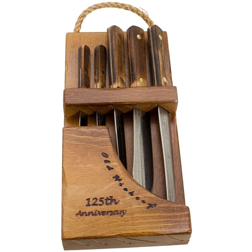 Кухонный набор Ontario Old HickoryНаборы кухонных ножей<br>Элегантный кухонный набор Ontario Old Hickory порадует поклонников традиций. Этот комплект кухонных ножей составлен из пяти предметов. А это: 2 овощных ножа (один поменьше, другой побольше) и 3 основных: обвалочный, нож-скинер и нож-слайсер. Обвалочный – он же филейный, он же заколочный. Нож-скинер (бучер) – многоцелевой нож мясника. Главный здесь, конечно, слайсер (шеф): без него стандартный набор кухонных ножей не обходится. Клинки – из углеродистой стали 1095. Ручки деревянные (орех). Монтаж простой и надежный. Благодаря красивой деревянной подставке-паковке – это готовый практичный и очень полезный подарок функционального содержания.<br>