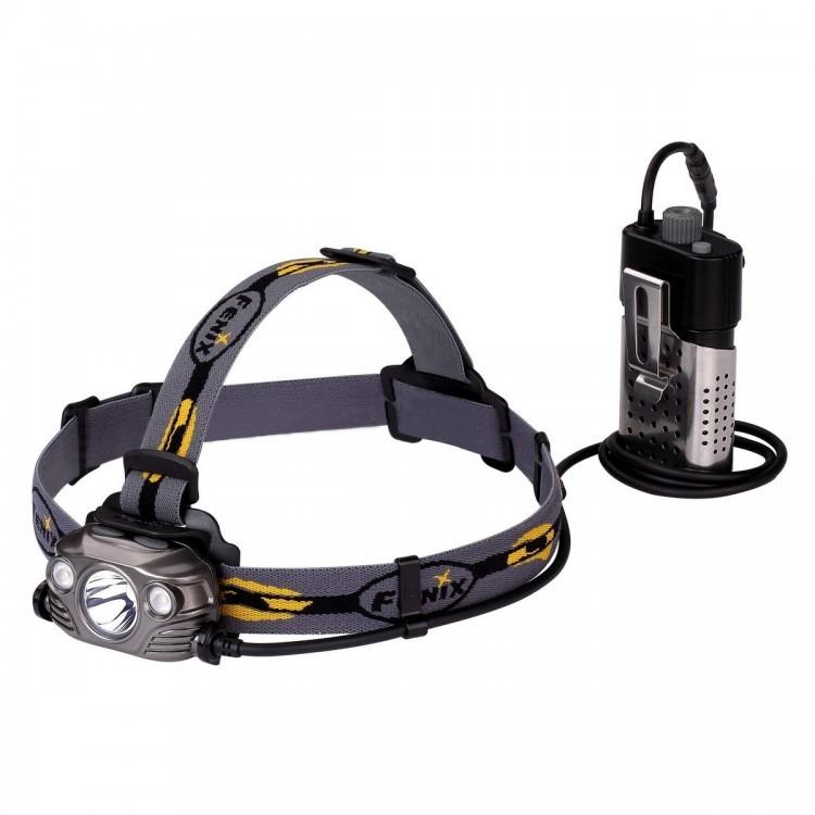 Налобный фонарь Fenix HP30R Cree XM-L2, XP-G2 (R5), серыйБренды ножей<br>Модели налобных фонарей очень универсальны по своей конструкции: они удобны для альпинизма, туризма, спелеологии, рыбалки, охоты, езды на велосипеде. Компания Fenix создала действительно мощный вариант такого фонаря — HP30R. В него вмонтировано сразу три диода, один из которых размещается в центральном рефлекторе и предназначен для дальнего освещения, а два — размещены по бокам и используются для ближнего света с широким углом луча. Управление диодами каждого типа — раздельное, а потому включать их можно и по отдельности, и вместе.<br>Помимо режима SOS для подачи сигналов в темноте, каждой группе диодов доступно еще по 4 уровня яркости света. Это 1000 люмен дальнего света и 750 люмен ближнего в режимах Turbo, по 400 люмен в обоих режимах High, по 130 — в Med, 30 люмен для дальнего света и 5 для ближнего — в режимах Low. Дистанция освещения может колебаться в зависимости от включенного режима в пределах 34-202 метра для дальнего освещения и 7-61 метра для ближнего освещения.<br>Необходимое электропитание фонарь получает от аккумуляторов, установленный во внешний отсек. Этот отсек соединен с головой фонаря при помощи длинного шнура, за счет чего его можно носить попросту в кармане, не нагружая голову лишним весом оборудования. Для Fenix HP30R потребуется два аккумулятора 18650. Их можно заряжать повторно непосредственно в корпусе фонаря, подключив к power-банку через кабель micro-USB. Уже заряженные аккумуляторы также могут использоваться в качестве power-банка, для чего к батарейному отсеку подключают кабель USB.<br>Fenix HP30R способен работать и с обыкновенными батарейками CR123A. Но в этом случае зарядные функции будут не доступны. Индикатор заряда также работает только в отношении аккумуляторов. Чтобы узнать остаток энергии в элементах питания, нужно нажать на кнопку индикатора и посмотреть, сколько диодов будут после этого светиться. Если четыре — аккумуляторы почти полные, если 3 — их заря