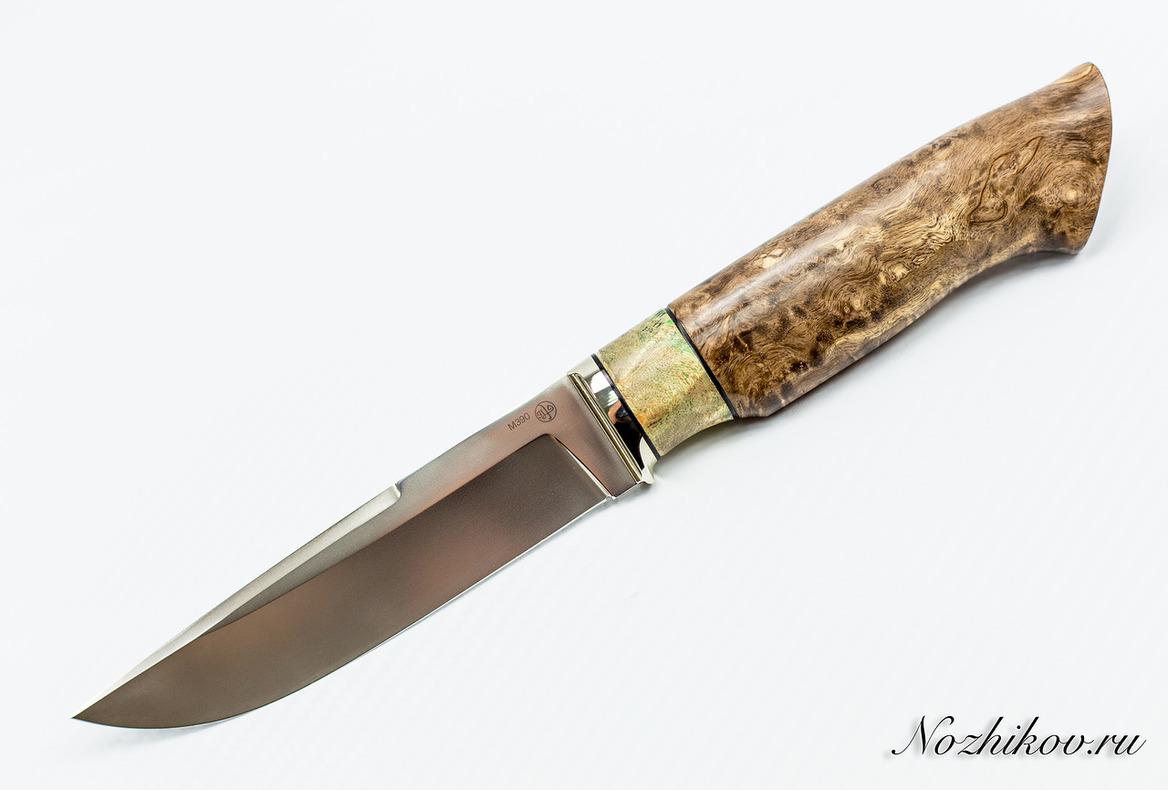 Нож Рабочий N57 из порошковой стали Bohler M390Ножи Павлово<br>Сталь: M390Рукоять:стабилизированная карельская береза, литье мельхиорДлина клинка (мм.): 132 Наибольшая ширина клинка (мм.): 28,5 Толщина обуха клинка (мм.): 3,1 Толщина подвода (мм.): 0,3-0,5 Твердость стали: 62-63Hrc Общая длина ножа (мм.): 266 Поверхность клинка: полировка, пескоструй Спуски клинка: вогнутые<br>
