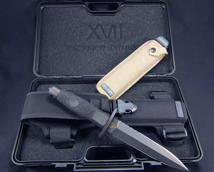 Нож с фиксированным клинком Adra Operativo Ordinanza 17° StormoВоенному<br>Нож с фиксированным клинком Adra Operativo Ordinanza , сталь N-690, 1/3 серейтер, клинок черный, рукоять черный эластимер, чехол пустынный кайдекс, пластиковая коробка.<br>