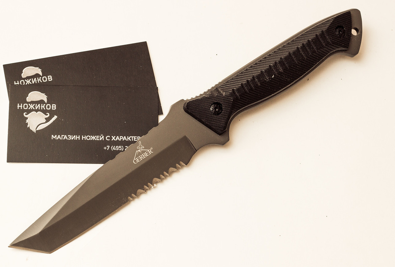 Нож Gerber ТантоНожи Танто<br>Тактический нож Warrant для выживания. Нержавеющее лезвие данного ножа имеет чёрное покрытие из нитрида титана и частично зазубренный край, что делает клинок более универсальным. Рукоятка ножа чёрная, вдоль неё идут вертикальные полосы, что обеспечивает уверенный и надёжный захват. Ножи Gerber Warrant предпочитают достаточно много военнослужащих разных стран.<br>Длина лезвия: 14 см<br>Длина (нетто) в мм: 24,1 см<br>Вес ножа, г: 154<br>Материал лезвия: нержавеющая сталь<br>Материал рукоятки: G-10<br>Тип покрытия: Титановая<br>Функции инструмента: Прямое лезвие<br>