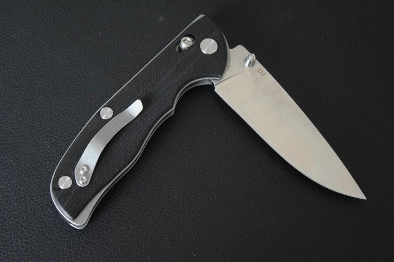 Складной нож, D2Раскладные ножи<br>Общая длина: 225 ммДлина клинка: 95 ммДлина в сложенном состоянии: 127 ммТолщина клинка: 4.0 ммВес: 175 гМатериал лезвия: d2Твердость: 59-61HRCМатериал ручки: G10<br>