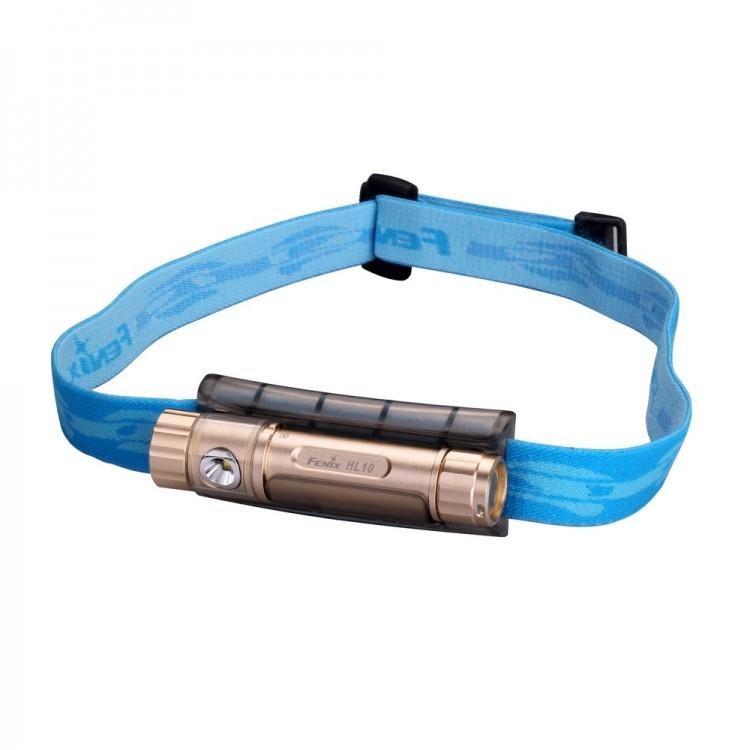 Налобный фонарь Fenix HL10 Philip LXZ2-5770 LED, золотистыйБренды ножей<br>Модель Fenix HL10, выпущенная в 2016 году, имеет множество преимуществ, которые делают ее прекрасным вариантом для повседневного применения. Этот фонарь очень компактный и без учета батарейки весить только 33 грамма. Он оснащен креплением на лоб, размер которого регулируется за счет эластичной ленты, поэтому хорошо подойдет для занятий спортом или других видов активностей. Впрочем, фонарь можно отсоединить от этого крепления и использовать вместе с металлическим кольцом в качестве брелка, например, на ключи. В данной модели используется качественный и очень долговечный светодиод - Philip LXZ2-5770. Он сохраняет работоспособность без существенных светопотерь на протяжении 50 тысяч рабочих часов. Яркость Fenix HL10 достигает 70 люмен. Этого вполне хватает, чтобы освещать пространство перед собою на 30 метров. Предусмотрены и два дополнительных режима с яркостью 30 люмен и 4 люмена. Дальность луча для них составляет, соответственно, 19 и 6 метров. Особенностью данной модели является возможность изменения угла для луча. Линза фонаря поворачивается и ее гладкая сторона дает более узконаправленный свет, а текстурная — широкий и мягкий. Помимо того, фонарь легко поворачивается в наголовном креплении по вертикали, позволяя легко и плавно настраивать направление освещения. Нужно сказать, что даже для такого компактного фонарика производители использовали стабилизацию яркости. Поэтому он всегда в заданном режиме будет светить равномерно, без миганий и понижения яркости. А вот памяти для установок освещения в данной модели нет, потому включаться фонарь будет каждый раз в самом экономном режиме.<br>Кнопка управления Fenix HL10 находится на торце корпуса. Обратная сторона корпуса — плоская, что позволяет поставить фонарь вертикально, для стационарного освещения. Кстати говоря, Fenix HL10 получил влагоизолированный корпус, соответствующий стандарту IPX-8. Фонарик вполне способен продолжать работу даже под 