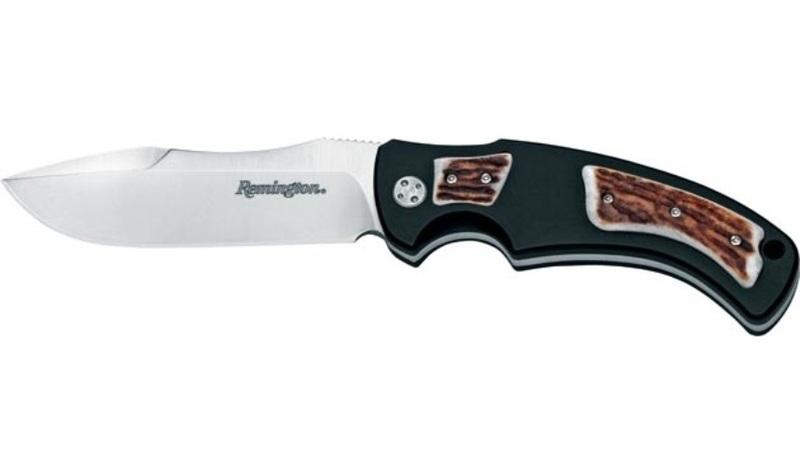 Нож с фиксированным клинком Remington Elite Hunter I RM\900FC CEРаскладные ножи<br>Нож с фиксированным клинком Remington Elite Hunter I RM\900FC CE представляет собой универсальную модель средних габаритов. Клинок изготовлен из твердой стали 440C, которая обладает достаточной вязкостью и позволяет длительный период сохранять остроту. Профиль клинка Bowie позволяет использовать режущий инструмент для выполнения как грубых, так и деликатных работ. Рукоять из анодированного алюминиевого сплава отличается особой прочностью. Ее накладки крепятся сбоков кхвостовику назаклепки или винты. Данный способ монтажа Full-Tang является самым надежным. Нож с серрейторной заточкой на обухе поможет справиться с множеством задач как в походе, так и на охоте.<br>