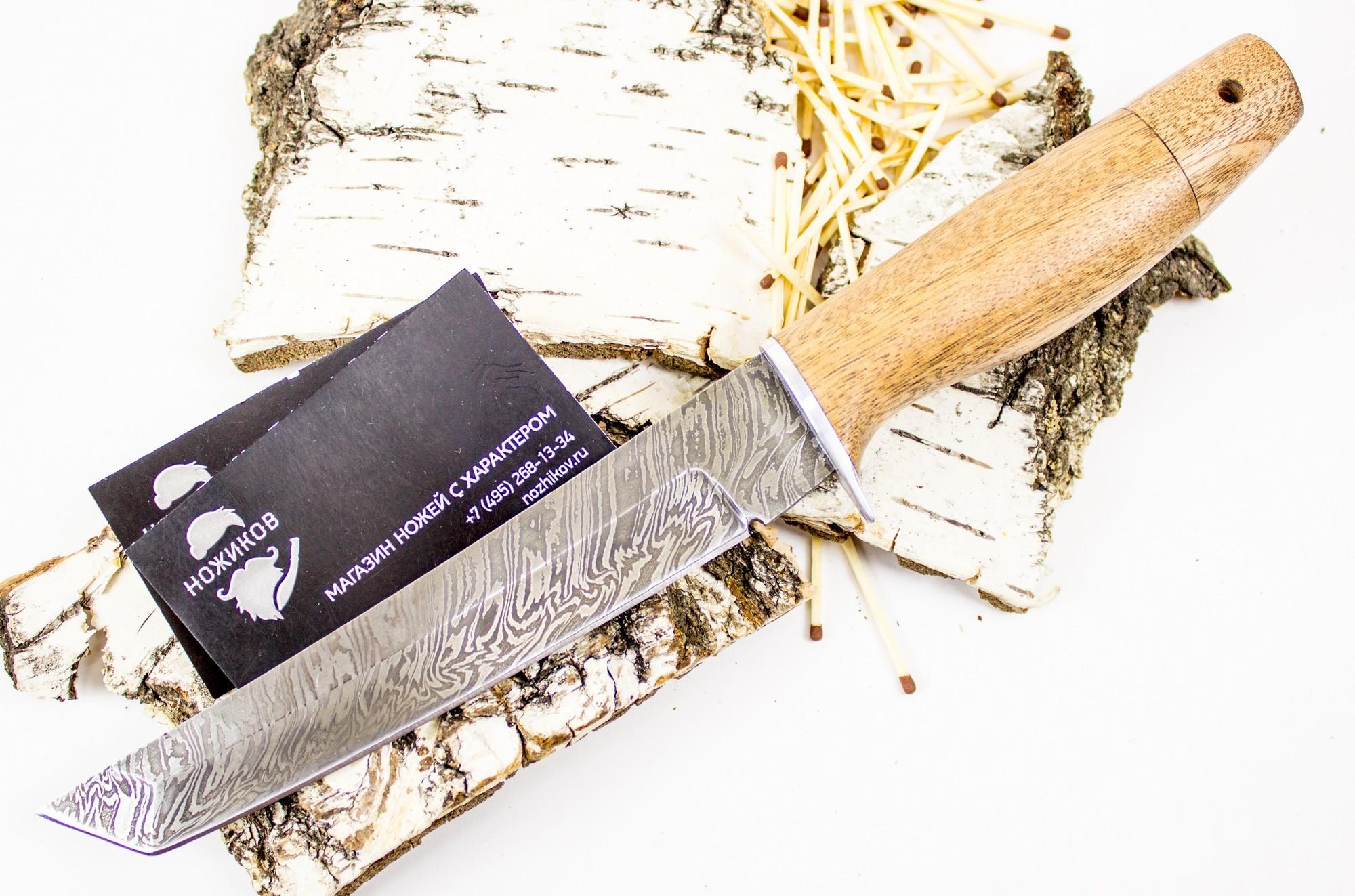 Нож Танто, сталь дамаскНожи Ворсма<br>Универсальный нож для рыболовов и туристов. Клинок выполнен в стиле Японских-Американских ножей, с двухсторонней заточкой, из дамасской стали. Проникающая и пробиваемая способность тантоидов превосходная. Благодаря достаточно большому углу острия ножа и характерному для танто толстому обуху. Нож обладает высокой износостойкостью и очень высокой коррозионной стойкостью.<br>