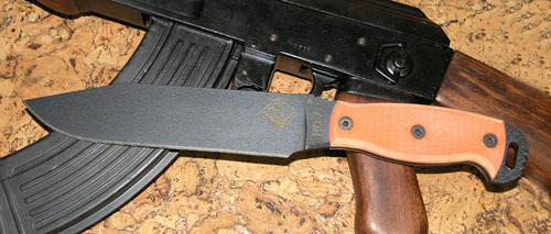 Нож с фиксированным клинком Ontario RD7 Tan micartaOntario Knife Company<br>Нож RD7 Tan micarta, сталь 5160, клинок черный, рукоять с отверстием (микарта), чехол черный нейлон с внутренним пластиком.<br>