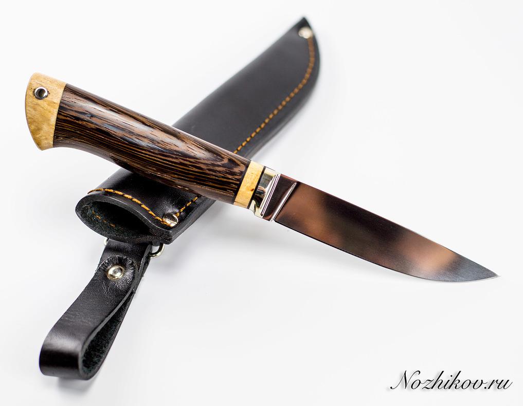 Нож Практичный №60 из кованой стали Х12МФНожи Павлово<br>Сталь: Х12МФРукоять: рукоять венге и карельская береза, литье мельхиорДлина клинка (мм.): 115 Наибольшая ширина клинка (мм.): 23 Толщина обуха клинка (мм.): 3.4 Толщина подвода (мм.): 0,4-0,6 Твердость стали: 60-61Hrc Общая длина ножа (мм.): 240 Поверхность клинка: Полировка Спуски клинка: Вогнутая линза<br>