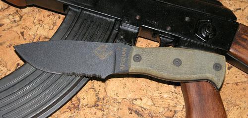 Нож с фиксированным клинком Ontario Afhgan - Black MicartaOntario Knife Company<br>Нож Afhgan - Black Micarta, сталь 5160, серейтор, клинок черный, рукоять (микарта), чехол черный нейлон с внутренним пластиком.<br>