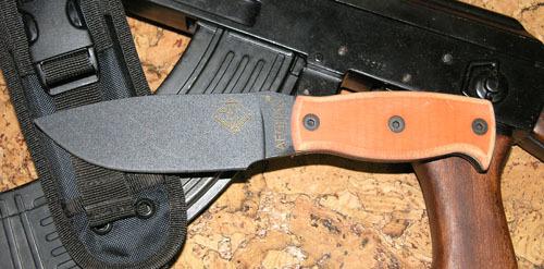 Нож с фиксированным клинком Ontario Afhgan - Orange G10Ontario Knife Company<br>Нож Afhgan - Orange G10, сталь 5160, клинок черный, рукоять (микарта), чехол черный нейлон с внутренним пластиком.<br>