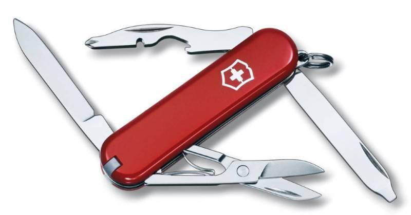 Нож перочинный Victorinox Rambler 0.6363 58мм 10 функций красныйШвейцарские ножи Victorinox<br>Нож - брелок RAMBLER - это многофункциональный инструмент с набором из 10 функций: <br>Лезвие<br>Ножницы<br>Кольцо для ключей<br>Пинцет<br>Зубочистка<br>Пилка для ногтей с: <br>- Отверткой<br>Открывалка для бутылок с:<br>- Магнитной крестовой отверткой<br>- Инструментом для снятия изоляции<br>Длина: 58 мм<br>Цвет: Красный<br>