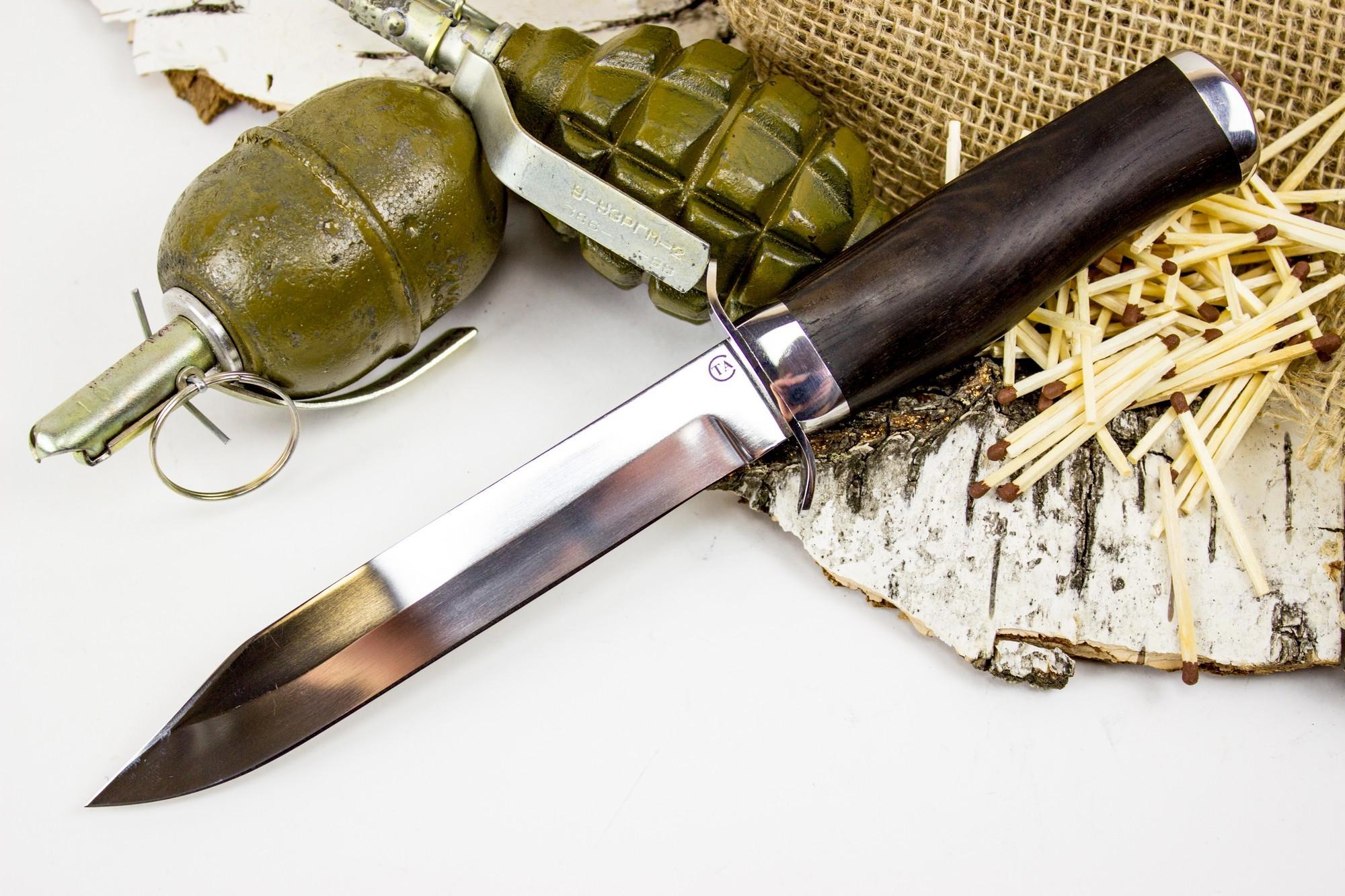 Нож Спецназ Вишня, сталь 95х18, грабНожи разведчика НР, Финки НКВД<br>Нож Спецназ Вишня выполнен по мотивам легендарного ножа военного времени НР-43. Среди полезных особенностей стоит отметить безопасное и уверенное удержание ножа в процессе выполнения работы. Это достигается за счет гарды, а также за счет утолщения рукояти в области указательного и среднего пальца. Такой нож удобно использовать на рыбалке или охоте. Если вы часто ездите на пикники, то и там ножу найдется работа. К тому же, имея такой нож, вы всегда будете в центре внимания, как знаток и ценитель ножевой истории нашей страны. Для удобного хранения и ношения, нож комплектуется кожаными ножнами с петлей для подвеса.<br>