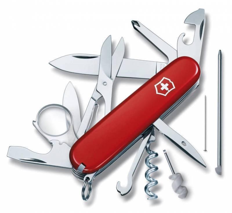 Нож перочинный Victorinox Explorer 1.6705 91мм 19 функций красныйШвейцарские армейские ножи Victorinox<br>Серия Швейцарские армейские ножи большого размера, 91 мм Офицерский нож EXPLORER – это многофункциональный инструмент с набором из 19 функций: Большое лезвие Малое лезвие Штопор Консервный нож с: – Малой отверткой (также для винта с крестообразным шлицем) Открывалка для бутылок с: – Отверткой – Инструментом для снятия изоляции Шило, кернер Кольцо для ключей Пинцет Зубочистка Ножницы Многофункциональный крючок Крестовая отвертка Лупа 8x Шариковая ручка с чернилами под давлением Булавка (нержавеющая сталь) Мини-отвертка Длина: 91 мм<br>