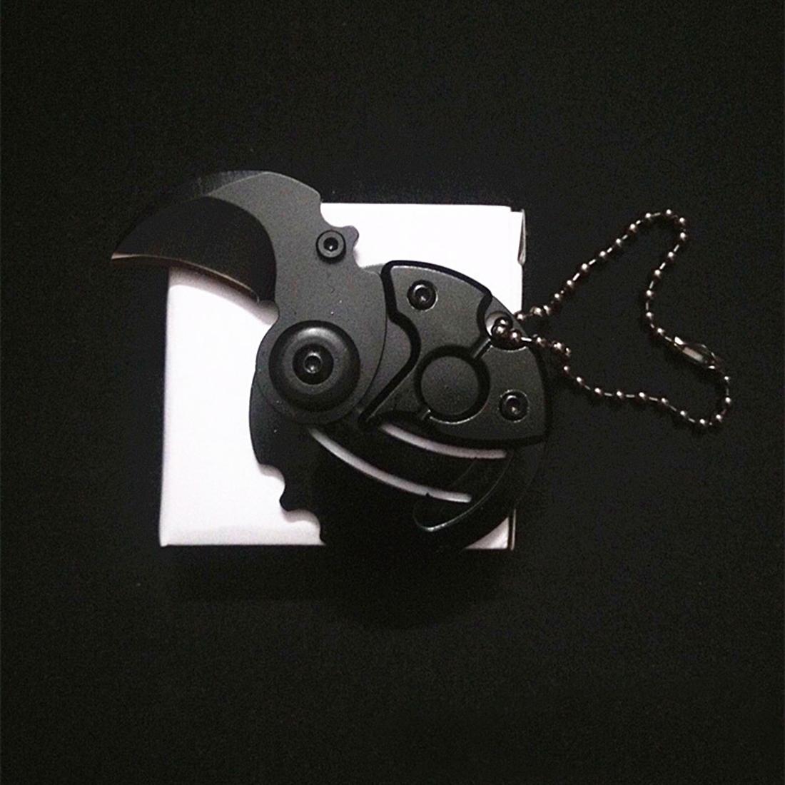 Фото 3 - Брелок монета со скрытым ножом, черная