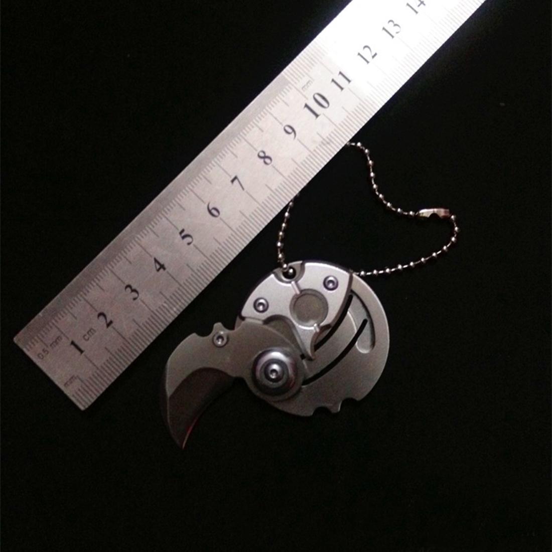 Фото 4 - Брелок монета со скрытым ножом, черная