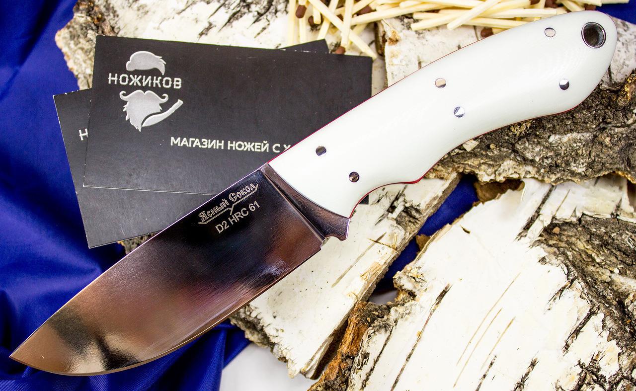 Нож Сова белая, D2Ножи Павлово<br>ХарактеристикиМарка стали клинка: D2Длина ножа (мм): 210Длина клинка (мм): 100Длина рукояти (мм): 110Наибольшая ширина клинка (мм): 31Толщина обуха (мм): 4,5Спуски: прямыеТвердость стали: 61 HRCМатериал рукояти: G-10Материал ножен: кожаСтрана изготовитель: РоссияПроизводитель: Ясный Сокол<br>