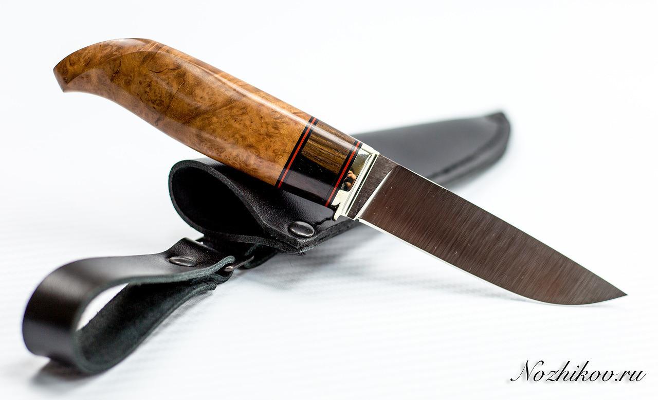 Нож Финка №53 из ElmaxНожи разведчика НР, Финки НКВД<br>Сталь: ElmaxРукоять: рукоять кокоболо, эбен, литье мельхиорДлина клинка (мм.): 109 Наибольшая ширина клинка (мм.): 28,5 Толщина обуха клинка (мм.): 3,5-3,6 Толщина подвода (мм.): 0,3-0,5 Твердость стали: 60-61Hrc Общая длина ножа (мм.): 235<br>