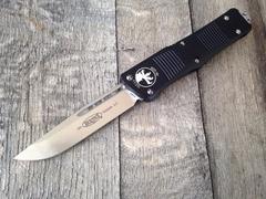 Автоматический фронтальный выкидной нож Troodon - Microtech 139-4 Black, сталь M390, рукоять алюминий, фото 5