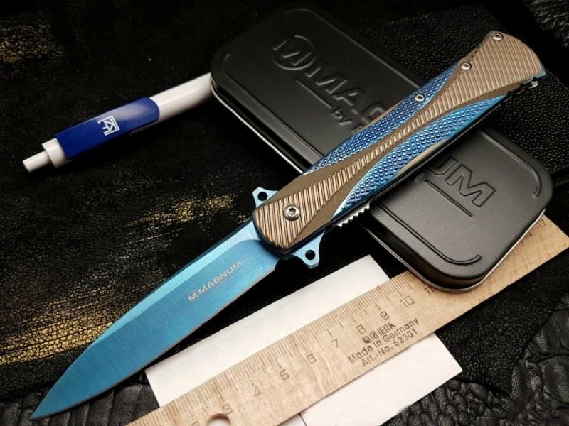 Фото 12 - Складной нож Magnum SE Dagger Blue - Boker 01LG114, сталь 440A Titanium Nitride, рукоять нержавеющая сталь, синий/песочный