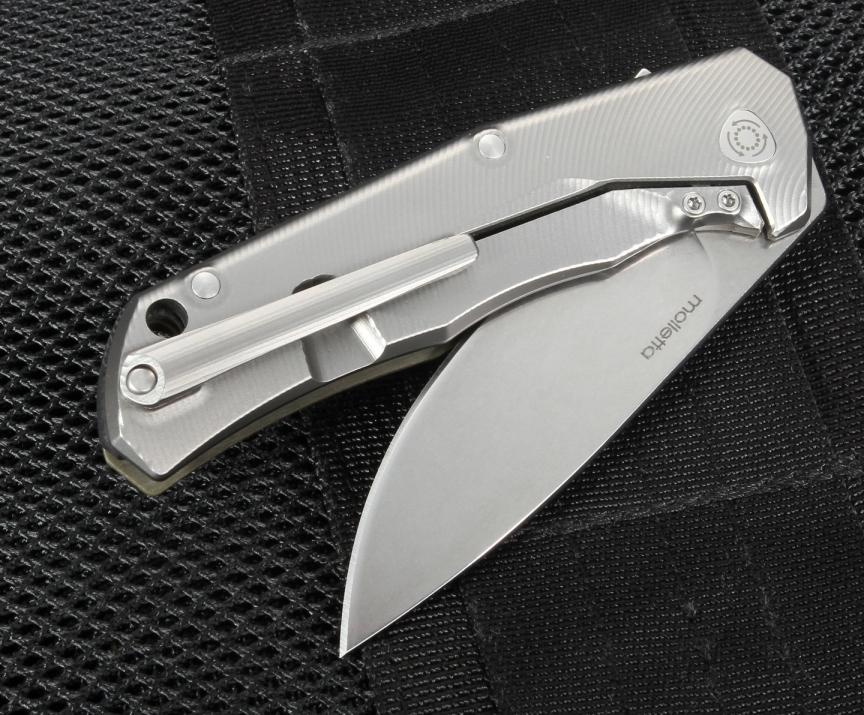 Фото 5 - Нож складной LionSteel T.R.E. G10 Black, сталь M390, рукоять G10/титан от Lion Steel