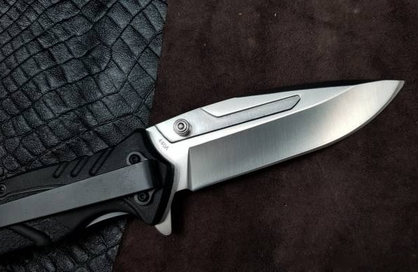 Фото 4 - Нож складной Boker Magnum Breaking Glass, сталь 440C Satin Plain, рукоять стеклотекстолит G10, 01MB718